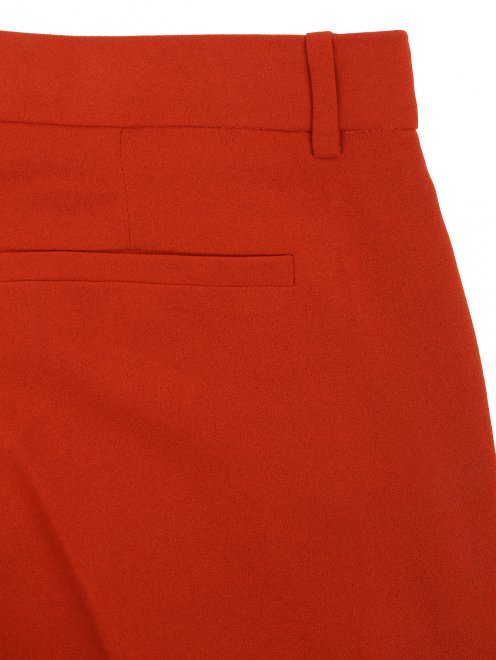 Расклешенные брюки со стрелками - Деталь1